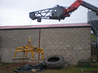 Winch powered fly jib next to large tyres